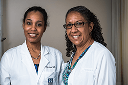 Two smiling female physicians