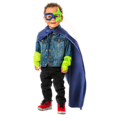 Little boy wearing a mask and super hero cape